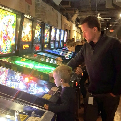 Boy and Dad playing pinball at restaurant Kalamazoo